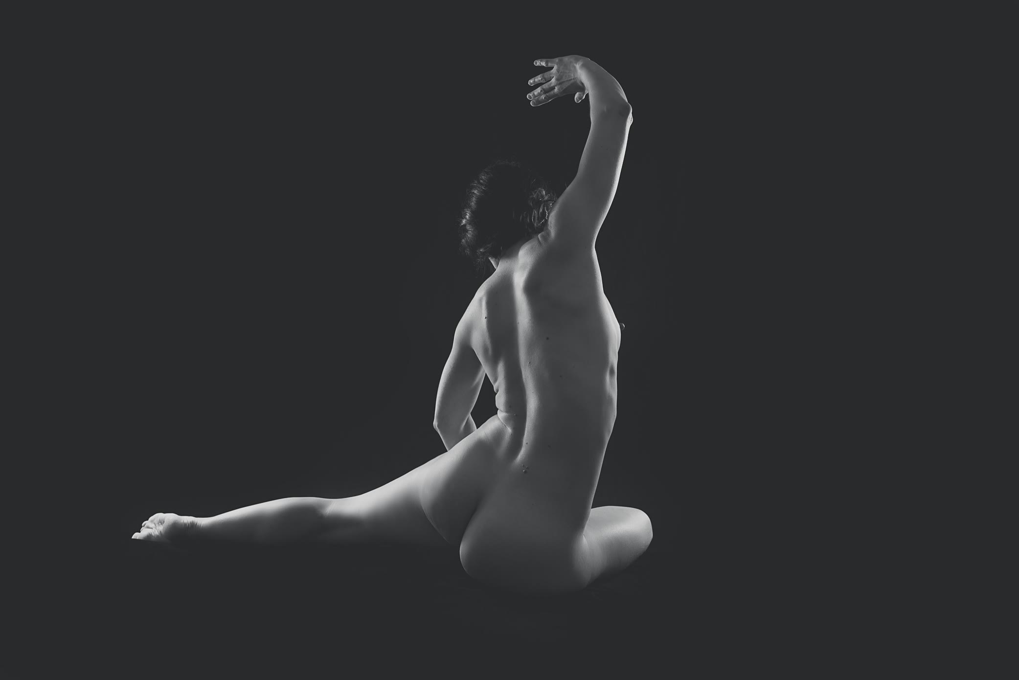 Nude female back view stretching by Gpix Photo