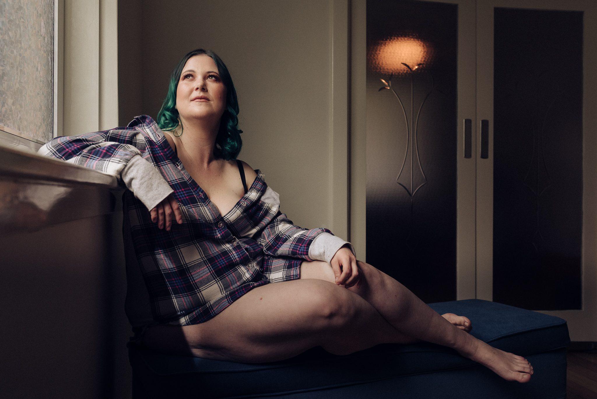 Boudoir portrait of a woman in a tartan shirt