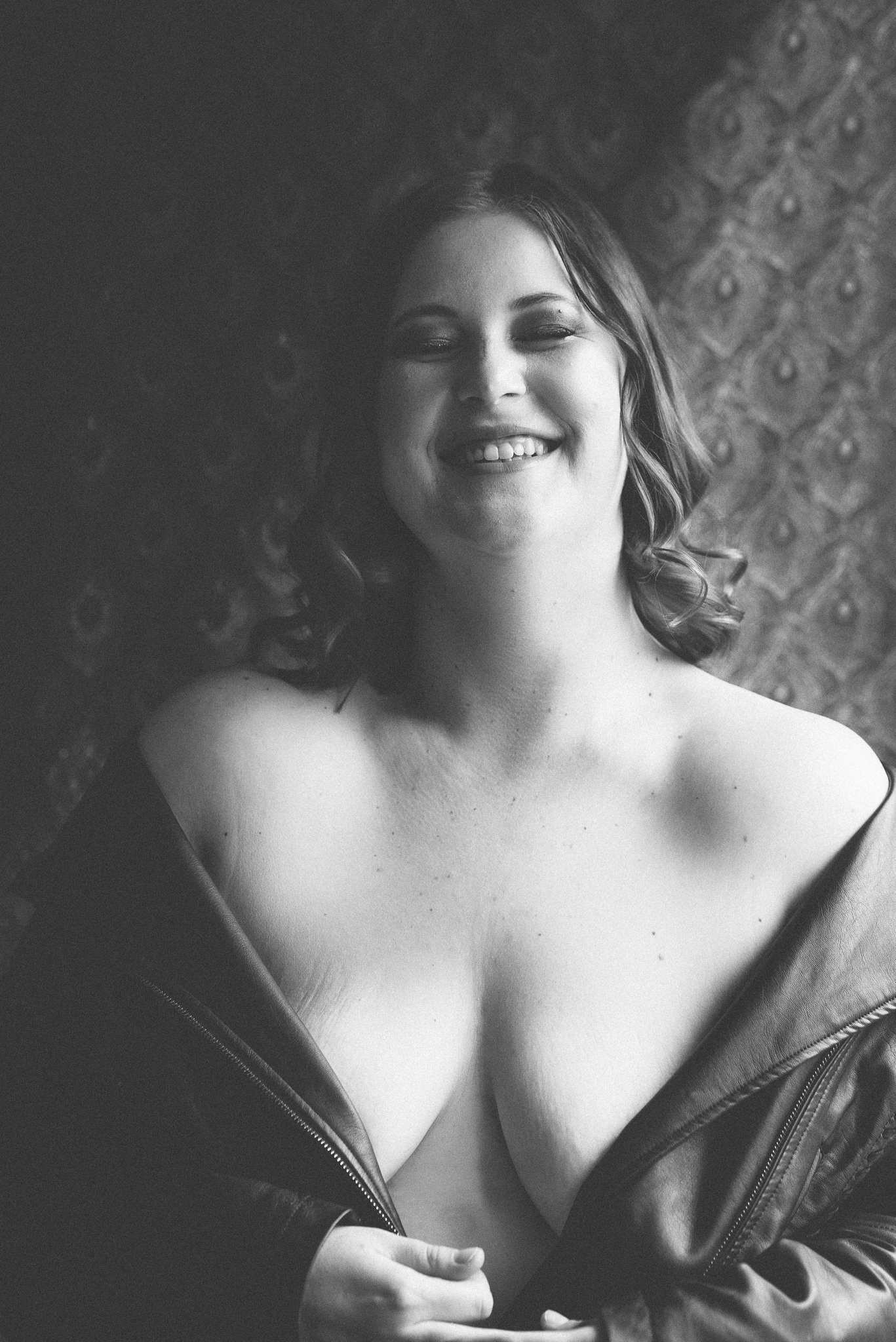Black and white portrait of woman laughing