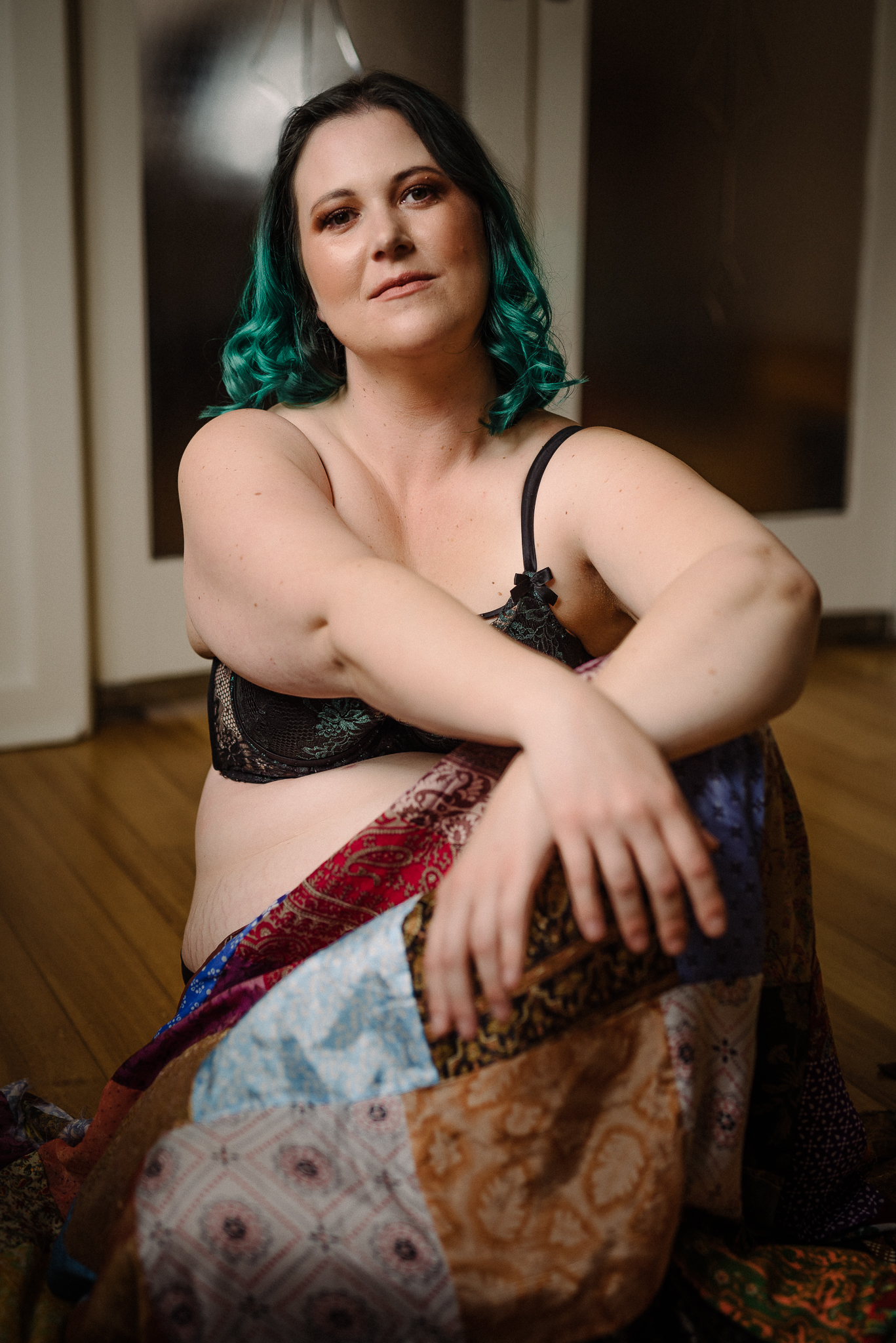 Portrait of a lady with green hair and a colourful skirt